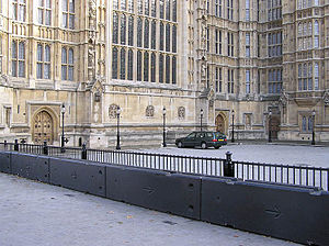 Vehicle-ramming attack - Security measures taken to protect the Houses of Parliament in London, UK. These heavy blocks of concrete are designed to prevent a car bomb or other device being rammed into the building.