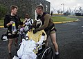 Naval Aircrewmen 2nd Class Logan Parkinson and Brandon Larnard prepare a patient for evacuation during relief efforts in the wake of Hurricane Maria (37206117952).jpg
