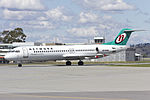 Network Aviation (VH-NHM) Fokker 100 taxiing at Wagga Wagga Airport.jpg