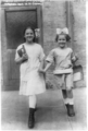 New York City school children. 2 girls with shining faces, opening day.png