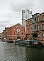 New buildings, old barges, in the Leeds and Liverpool Canal.jpg
