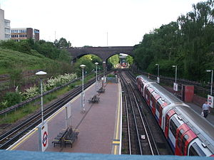 North Acton tube station - Facing east in May 2008. Tracks from the left were once two of the NNML, two GWR freight and two Central line track beds. The closer bridge carries Victoria Road; that beyond carries the North London Line.
