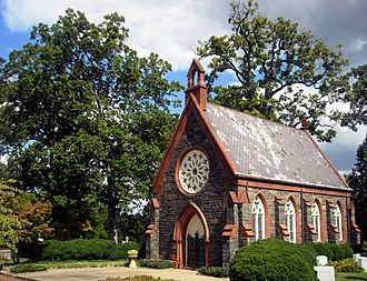 Oak Hill Cemetery Chapel, designed by James Renwick, Jr. in 1850, is listed on the National Register of Historic Places. Oak Hill Cemetery Chapel, DC.jpg