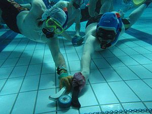 Underwater hockey - Two players competing for the puck at GB Student Nationals, Bangor in 2009.