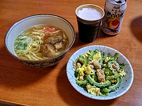 Okinawa soba and Goya chanpuru with a tap of local Orion beer