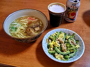 Longevity in Okinawa - The plate to the right is the national dish, goya chanpuru, made with bitter melon known as goyain.