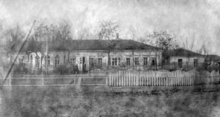 Photograph of a single story wooden farmhouse