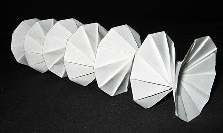 Spring Into Action, designed by Jeff Beynon, made from a single rectangular piece of paper. Origami spring.jpg