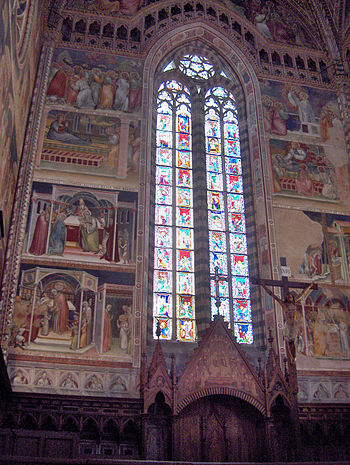 English: Apse: stained-glass quadrifore; fresc...