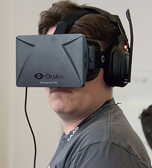 Palmer Luckey - Palmer Luckey wearing an Oculus Rift DK1 (development kit 1) during a demo at SVVR 2014.