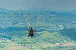 Paraglider in the air (43973945294).jpg