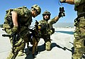 Pararescueman train with Army, military canines (9242361472).jpg