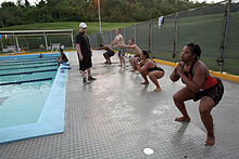 Participants with the Water Warrior class perform squats prior to entering the pool at Camp Foster, Okinawa, Japan, July 6, 2011 110706-M-VD776-004.jpg