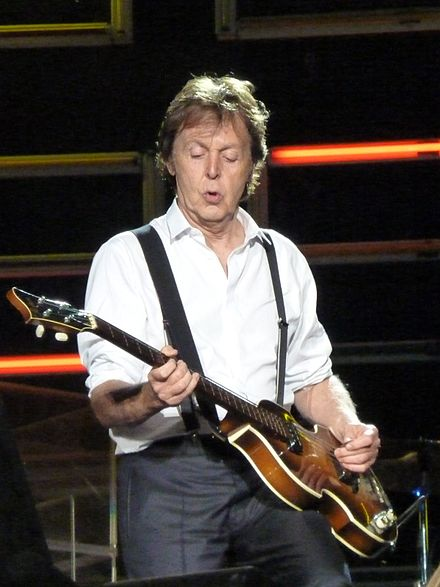 Paul McCartney mutes strings with picking hand. Paul McCartney live in Dublin.jpg