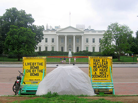 """Live by the bomb die by the bomb"" at the White House Peace Vigil. PeacePark.jpg"
