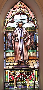 The Melanchthon window attributed to the Quaker City Stained Glass Company of Philadelphia, Pennsylvania, at St. Matthew's German Evangelical Lutheran Church in Charleston, South Carolina (Source: Wikimedia)