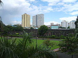 The Plaza de Armas is the only green space in Fort Santiago, surrounded by plants and the fort's ruins