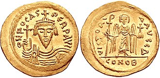 Phocas - Coin of Phocas. Constantinople mint, 4th officina. Struck 604-607. ON FOCAS PЄRP AVI, crowned and cuirassed facing bust, holding globus cruciger / VICTORI A AVςЧ, Angel standing facing, holding globus cruciger and long staff terminating in staurogram; Δ//CONOB.