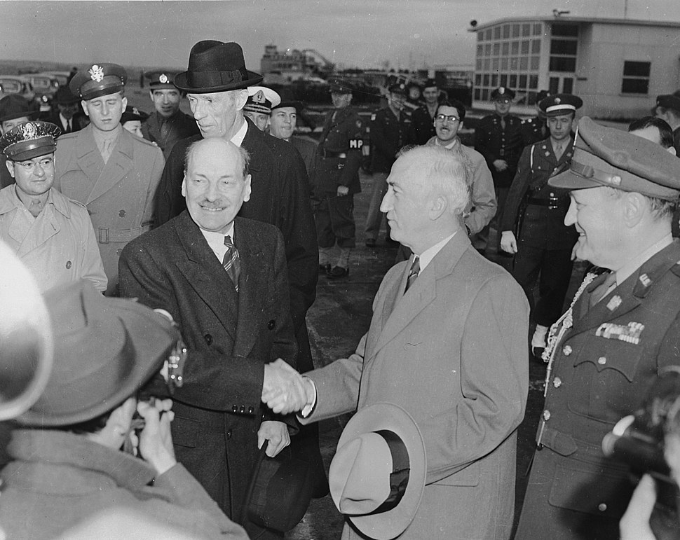 Photograph of British Prime Minister Clement Attlee shaking hands with Secretary of State James Byrnes upon his... - NARA - 199245