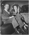 Photograph of Gerald R. Ford, Jr., and Betty Ford Sitting in the Back Seat of an Automobile Outside of Grace... - NARA - 186889.tif