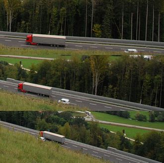 Passing lane - A car passes a slower moving truck, using a passing lane on the A2 motorway in Slovenia