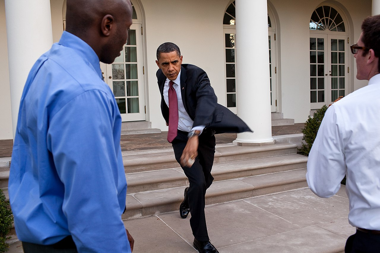 Photo of President Obama practicing a baseball pitch