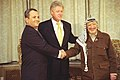 President Bill Clinton with Prime Minister Ehud Barak of Israel and Chairman Yasser Arafat of the Palestinian Authority.jpg