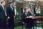 President George H. W. Bush signs the Civil Rights Commission Reauthorization Act in the Rose Garden of the White House.jpg