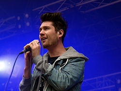 Lead vocalist Dan Smith holding a microphone