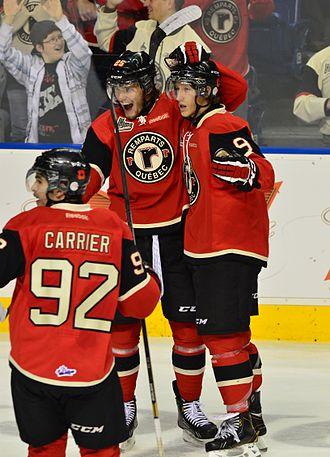Mikhail Grigorenko - Mikhail Grigorenko (25) in the center celebrating a goal with Quebec Remparts' teammates