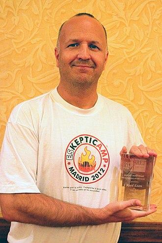 SkeptiCamp - Reed Esau founder of SkeptiCamp, with JREF award
