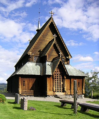 Stave church - Reinli stave church with the old pillory, Sør-Aurdal