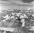 Rendu Glacier, rock covered tidewater glacier terminus and hanging glaciers, August 27, 1969 (GLACIERS 5825).jpg