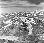 Rendu Glacier, rock covered tidewater glacier terminus and hanging glaciers, August 27, 1969 (GLACIERS 5825).jpg