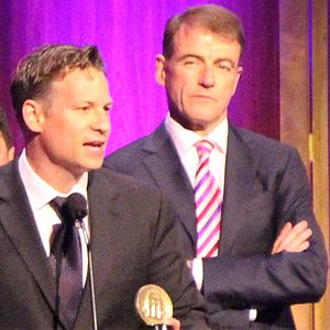 Bill Neely - Bill Neely (right) listens as his colleague Richard Engel accepts a 2014 Peabody Award on behalf of their news team in 2015.