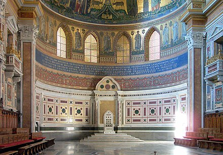 The chair (cathedra) of the Supreme Pontiff (Pope) of the Catholic Church in the Archbasilica of St. John in Lateran in Rome, Italy represents his episcopal authority. Roma-san giovanni03.jpg