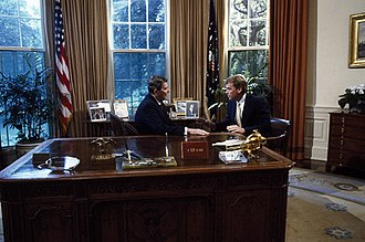 Dan Quayle - President Ronald Reagan speaks with Senator Dan Quayle at his desk in the Oval Office in 1986.