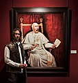"""Ross Kolby in front of his canvas """"And the truth shall make you free"""" at the exhibition """"Portrait Now!"""" at Museum of National History in Copenhagen 2015.jpg"""