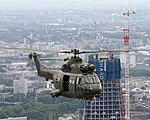 Royal Air Force 230 Squadron Puma HC1 flying past The Shard skyscrape.jpg