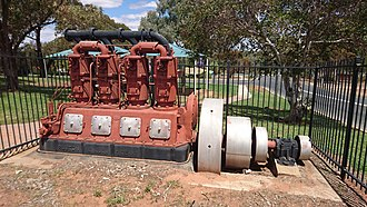 Stationary engine - Rushton 4cyl oil-diesel engine. This ran as an engine driving an irrigation pump to draw water from the Murray River for the Coomealla Irrigation Area. It is now an exhibit.