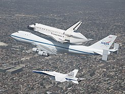SCA and Endeavour escorted by FA-18, on approach to LAX (ED12-0317-60).jpg
