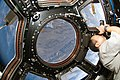 STS-130 Soichi Noguchi photographs through Cupola.jpg