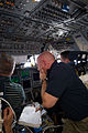 STS-134 Mark Kelly, Greg H. Johnson and Roberto Vittori on the flight deck during docking.jpg
