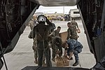 Sailors and Marines unload military field rations from an MV-22 Osprey aircraft in San Juan, (37075027110).jpg