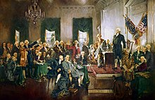 Paiting by Howard Chandler Christy of the signing of the Constitution of the United States.  George Washington stands on a dias at right with men sitting and standing in the middle third of the painting. The other central figures of the paiting are Alexander Hamilton, Benjamin Franklin and James Madison.