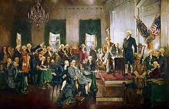 An oil-on-canvas painting of delegates to the Constitutional Convention as they signed the proposed frame of government in Independence Hall. George Washington is standing upright and looking out over the delegates.