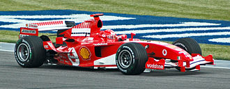Bridgestone - Schumacher in practice at the 2005 United States Grand Prix. Note the Bridgestone branding on the rear wing endplate, the Bridgestone's 'B' logo on the front wing, just under the nosecone and on the side winglet just before the rear wheel.