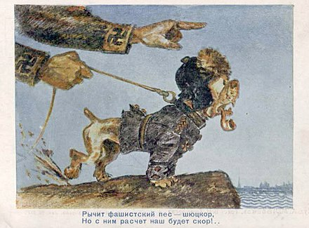 "A Soviet propaganda postcard from 1940 saying ""the fascist dog growls"" and referring to the Finnish White Guard (Shiutskor), the paramilitary forces that had a role in defeating the socialist Reds in Finland during the Civil War of 1918 Schutzcor1940.jpg"