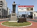 Sculpture of Fukuzawa Yukichi in front of north entrance of Nakatsu Station.jpg