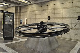Pioneer Square station - A preserved cable car flywheel on display at Pioneer Square station after its discovery during tunnel construction